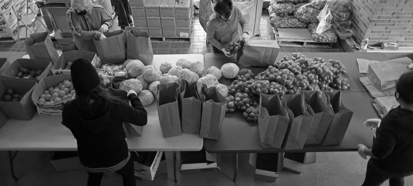 picture of people filling bags with food to give to people in need