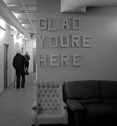 image of a hallway with a sign that reads glad you are here